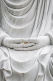Buddha statue with hands as main subject. Royalty Free Stock Images