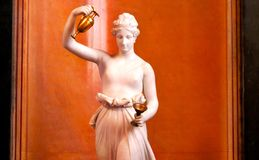 Marble statue and a cup Stock Photos