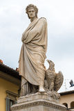 Marble statue of Dante Alighieri in Florence. Marble statue of Dante Alighieri with eagle shot from below in Piazza Santa Croce in Florence Stock Photography