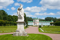 Marble statue in front of the palace Royalty Free Stock Photos