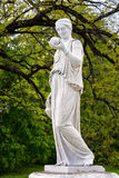 Marble statue of the Greek goddess Hera or the. Roman goddess Juno, holding an apple of discord in the park of the Palace and park complex Estate of G. Galagan Royalty Free Stock Photography