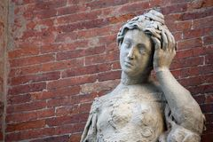 Marble statue with headaches and the brick wall Royalty Free Stock Images