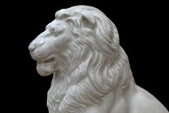 Marble statue of lion on a black background Royalty Free Stock Photos