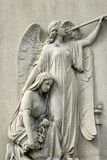 Marble Statue of Mourning Woman and Angel Royalty Free Stock Photo
