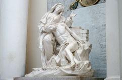 The marble statue of the Virgin Mary who is holding on his knees of Jesus Christ in Basilica di San Giovanni in Laterano in Rome, Stock Image