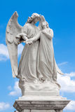 Statue of an angel guarding a beautiful young girl Stock Images