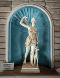 Marble statue of young woman Artemis Stock Image