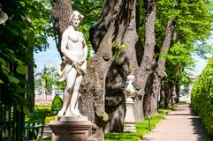 Marble statues along green valley in the park Royalty Free Stock Photos