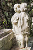 Marble statues in the cemetery. One of the many statues located in the cemetery of Staglieno in Genoa Stock Image
