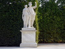Marble statues in a garden. Marble classical statue on a basement Stock Image