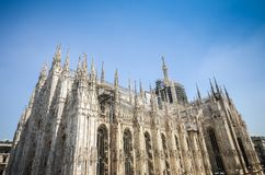 Marble statues of Saints on the spires of the Milan Cathedral Duomo di Milano in Milan Lombardy, Italy. Milano Duomo, one of the biggest Gothic style church in Royalty Free Stock Photography