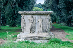 Marble stele stone pedestal with sculptures of ancient images of emperors and senators in park at Villa Pamphili in Rome, capital Royalty Free Stock Photography