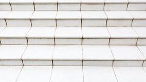 Marble stone granite white stairs. Textured background. Close up image stock photo