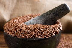 Marble stone mortar full of flax seeds Stock Photos