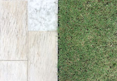 Marble Stone Pattern Sidewalk with Grasses in The Garden Royalty Free Stock Photos