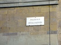 Marble Street Name Sign, Piazzale degli Uffizi, Florence, Italy. The Piazzale degli Uffizi passes through the Ufizzi Gallery buildings, Florence, Tuscany, Italy Stock Photo