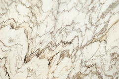 Marble surface. Texture of a tarnish block of marble freshly cut in the quarry Stock Photo