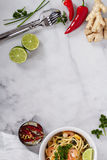 Marble table with asian cooking ingredients Stock Photography