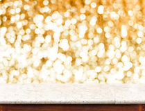 Marble Table with bokeh golden sparkling background,Empty room f Royalty Free Stock Images