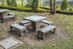 Marble table with checkerboard in the garden. Stone table with checkerboard in the garden stock photos