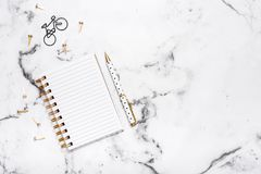 Marble table flat lay with open notebook and pen for planning, bloggers, students, office Royalty Free Stock Photos