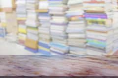 Marble table with library blur background.  stock photos