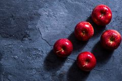 On the table are three red apples royalty free stock photo