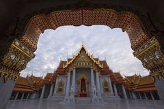 Marble temple and puffy clouds. In the morning Stock Photos