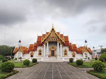 Marble temple under cloudy sky. The Marble Temple (Wat Benjamabophit) was under the cloudy sky, Bangkok Thailand Royalty Free Stock Image