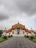 Marble temple under cloudy sky. The Marble Temple (Wat Benjamabophit) was under the cloudy sky, Bangkok Thailand Stock Photo