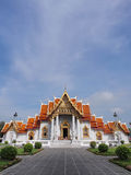 Marble temple under cloudy sky. The Marble Temple (Wat Benjamabophit) was under the cloudy sky, Bangkok Thailand Royalty Free Stock Photos