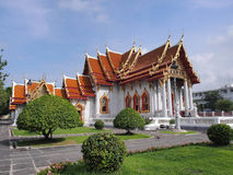 Marble temple under cloudy sky. The Marble Temple (Wat Benjamabophit) was under the cloudy sky, Bangkok Thailand Royalty Free Stock Photography