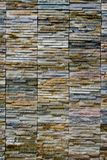 Marble Tile. Wall finished in thin strips of uneven marble tile forming an interesting pattern Royalty Free Stock Images