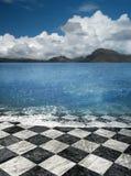 Marble tile beach illusion. Checkered marble tile sea shore beach illusion fantasy royalty free stock photo