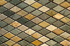Marble tile mosaic. Texture and color of a marble tile matrix Royalty Free Stock Photo