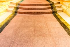 Marble tile of walkway with stairs. Brown marble walkway royalty free stock images