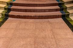 Marble tile of walkway with stairs. Brown marble walkway stock photography