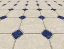 Marble tiled floor tiles. Large marble tiled floor background image with small blue tiles Royalty Free Stock Photography