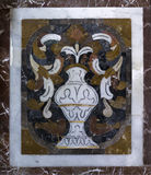 Marble tiling in a church of  Forza d`Argró. Marble decoration tiling from the 18th century in an old church of  Forza d`Argró on Sicily with vase, leafs and Royalty Free Stock Photo