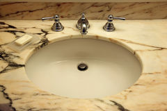 Marble top sink Royalty Free Stock Images