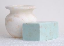 Marble Vase and Soap. White marble vase and a light blue bar of handmade soap Stock Images