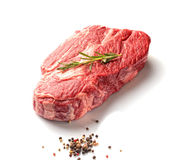 Marble veal with rosemary and aromatic spices on a white background Royalty Free Stock Images