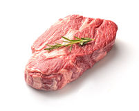 Marble veal steak with rosemary on a white background. Marble veal steak with rosemary Royalty Free Stock Photo