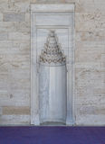 Marble wall with embedded niche Stock Image
