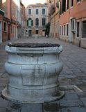 Marble well in calle of Venice in Italy Stock Image