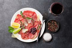 Marbled beef carpaccio and red wine stock photo