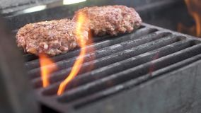 Marbled beef steaks. Fried on high heat. Flames and smoke in the frame. A barbecue on the weekend. The meat is fragrant thyme. The. Camera moves, changes focus stock video
