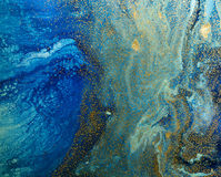 Marbled blue and golden abstract background. Liquid marble pattern.  royalty free stock photo