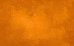 Marbled orange background in warm autumn halloween colors