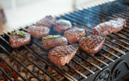 Marbled veal steaks are toasted on the grill Stock Photos